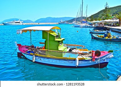 Sami, Kephalonia / Greece - 5/21/2018: Colourful fishing boat in the pretty harbour at the seaside resort of Sami, on the Greek holiday island of Kefalonia or Cephalonia.