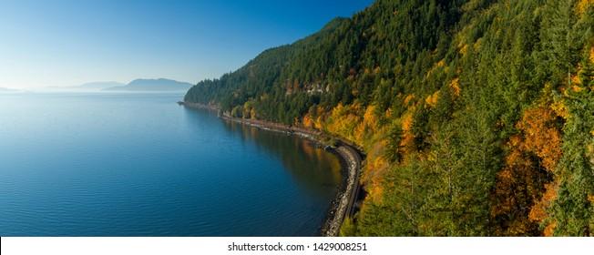 Samish Bay, WA - Chuckanut Drive Aerial View - Sunny Autumn Day - Railroad Tracks Along Water Coastline - San Juan Islands Background