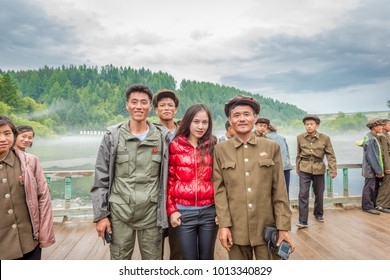 Samjiyon, North Korea-August 18 ,2016:Asian woman took pictures with North Korea Soldiers.