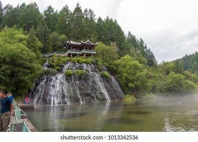 Samjiyon, North Korea-August 18 ,2016:the beautiful Rimyongsu Falls. The water comes from underground streams and breaks through the basalt rocks.