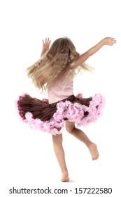 Samll dancing girl in studio