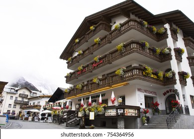 SAMNAUN, SWITZERLAND - SEPTEMBER 2: Swiss people and foreigner traveler travel rest and shopping duty free at shop in Samnaun village near Alps mountain on September 2, 2017 in Graubunden, Switzerland