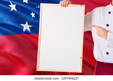Samoan Chef holding blank whiteboard menu on Samoa flag background. Cook wearing uniform pointing space for text.