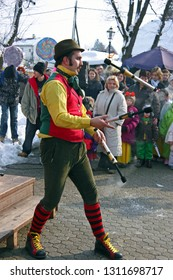 SAMOBOR, CROATIA - FEBRUARY 13, 2010: A street performer performs juggling with fire, Samobor carnival, Croatia
