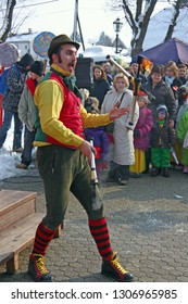 SAMOBOR, CROATIA - FEBRUARY 2, 2010: A street performer performs juggling with fire, Samobor carnival, Croatia