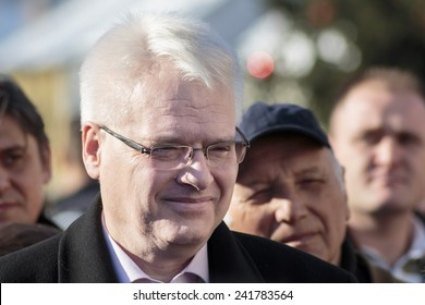 SAMOBOR, CROATIA - JANUARY 04, 2015: Ivo Josipovic the third President of Croatia on the promotion for the next presidential election in Croatia. The President is interacting with people.
