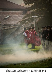 Samobor, Croatia, October 20, 2018. Honor guards firing traditional guns during celebration in town Samobor wearing traditional uniforms and hats