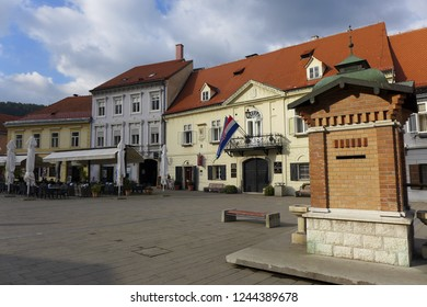 Samobor Croatia October 27th 2014 city square with fountain and flags