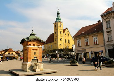 SAMOBOR, CROATIA-MAR. 24, 2015:  The quaint city center of Samobor, with its church in the background, is a tourist attraction because of a ruined castle on a nearby hill.