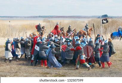 SAMOLVA, RUSSIA - APRIL 22: historical reconstruction of the Battle on the Ice, member(s) dressed in medieval armor on April 22, 2012 in village Samolva near Pskov, Russia.