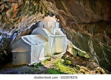"SAMOS ISLAND, AEGEAN SEA, GREECE. Panagia Makrini (literally ""Distant Virgin Mary"") church, hidden in a cave of Kerkis mountain, close to Kalithea village."