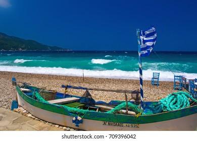 Samos island. Greece. Samos Kokkari Village. Boat, blue sky and blue white sea background.