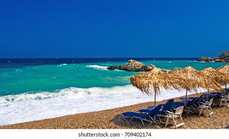 Samos island. Greece. Samos Kokkari Village. Blue sky and blue white sea background.