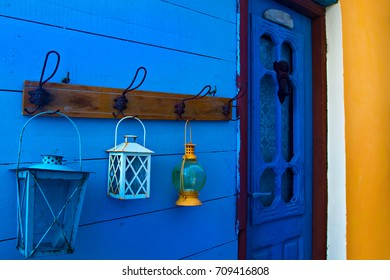 Samos island. Greece. Samos Kokkari Village. Colorful wall and blue, white, yellow lanterns.