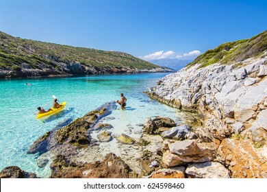 Samos Island, Greece - September 03, 2015 : People are swimming in Livadaki Beach. Livadaki Beach is populer beach in Samos Island.