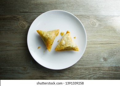 Samosa dish on wooden table