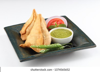SAMOSA famous and popular  Indian Snack served with green chilli and pudina or mint  chutney