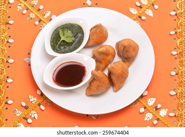 Samosa Indian traditional fast food snack dish isolated on decorative background in festival time