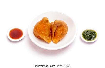 Samosa Indian traditional fast food snack dish isolated on white background