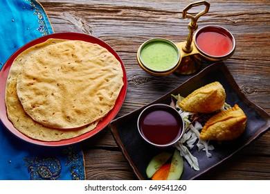 Samosa with Papadam indian recipe red and green sauces samoosa or sambusa