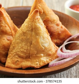 Samosa - Popular Indian snack made of fried pastry with savory vegetable filling close up, selective focus
