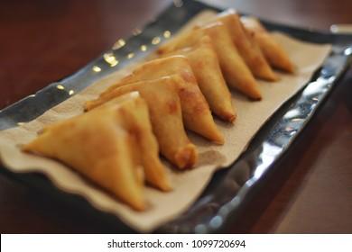 samosa, sambusa, or samboksa is a fried or baked dish with a savory filling