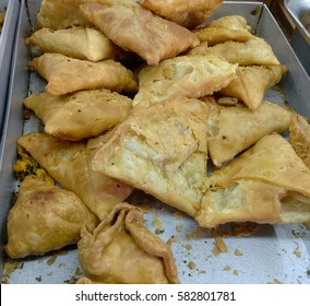 A samosa or samoosa, is a fried or baked dish with a savoury filling, such as spiced potatoes, onions, peas, lentils, macaroni, noodles or minced meat.