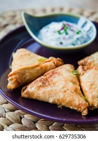 A samosa or samoosa is a fried or baked pastry with a savoury filling, such as spiced potatoes, onions, peas, lentils, macaroni, noodles, or minced meat-lamb, beef or chicken.