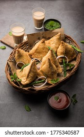 Samosa - Triangle shape fried / baked pastry with savoury filling, popular Indian Tea Time snacks, served with green chutney, tomato ketchup
