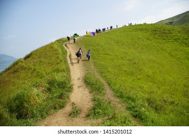 Samosir, Indonesia - ca 2019: Holbung Hill in Samosir: View of the Amazing Teletubbies Hill around Lake Toba