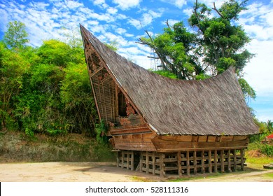 SAMOSIR, INDONESIA - MARCH 6: Traditional Batak house on March 6, 2012 on Samosir island, Indonesia. Samosir is the largest island within an island and the fifth largest lake island in the world.