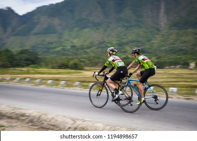 Samosir Island, North Sumatera/Indonesia-August 2018: The cyclists are welcomed by the beautiful panoramic view along the road of Samosir Island during the GFNY Bike Race Samosir.