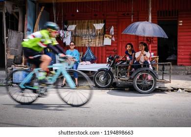 Samosir Island, North Sumatera/Indonesia-August 2018: The cyclists enjoy the road of Samosir Island during the GFNY Bike Race in Samosir Island. Samosir is a beautiful island located in north Sumatera