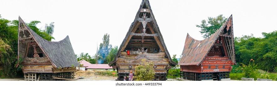 SAMOSIR ISLAND, NORTH SUMATRA INDONESIA - 22 JUNE 2016: Traditional batak-style houses at open air Huta Bolon Simanindo Batak Museum. Panorama shot