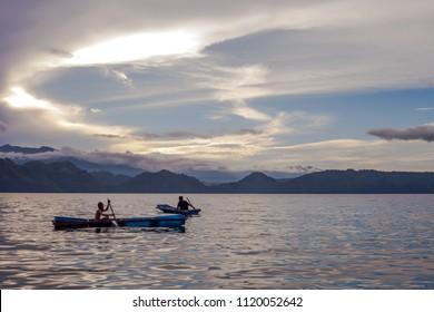 Samosir, North Sumatera / Indonesia - November 20 2017: A child and an adult floating around Lake Toba