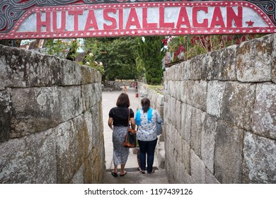 Samosir, North Sumatera/Indonesia-August 2018: The visitors enter the entrance of Huta Siallagan, a traditional village, in Samosir Island where visitors still can find the heritage of Batak ethnic.