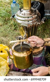 Samovar and old copper kettle. Russian tradition