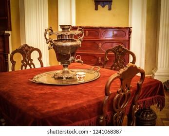 Samovar on the table in the vintage victorian era interior