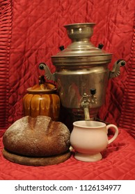 Samovar standing on a table with cup and bread