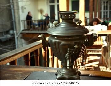 Samovar. Tea urn. Metal samovar on wood table. Tea time