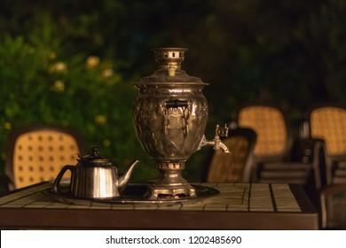 Samovar. Tea urn. Traditional turkish and azerbaijan samovar tea. Metal samovar on wood table. Tea time.