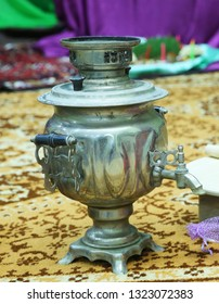 Samovars are typically crafted out of plain iron, copper, polished brass, bronze, silver, gold, tin, or nickel . Metal samovar on a background
