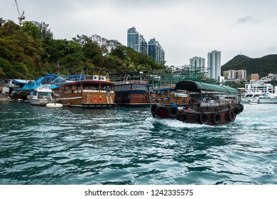 A sampan in Aberdeen habour, with typical house boats on the background. Aberdeen, Hong Kong, January 2018