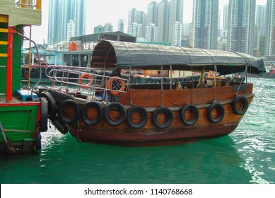 Sampan in Aberdeen Harbor, Hong Kong. Sampan rides are a popular tourist activity in Aberdeen Harbor because of the close proximity to the working fishing boats and the fishermen who work there.