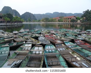 """sampan boat station shortly before dusk at Tam Coc known also as """"Halong Bay in thourgh rice fields"""", Central Vietnam, Ninh Binh province"""
