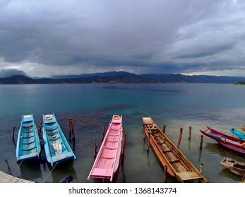 Sampan boats in Lugu Lake, Yunnan, China.