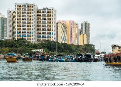 Sampan cruise in Aberdeen harbour, famous for the floating village with old junks and house boats, Hong Kong