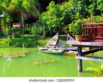 Sampan on the green lake in Cambodian Cultural Village, Siem Reap, Cambodia.