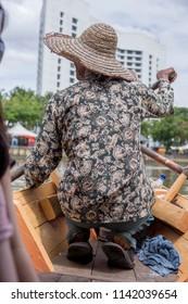 Sampan paddler at Kuching Waterfront, Sarawak, Malaysia