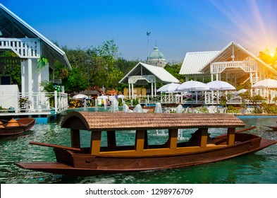Sampan is a relatively flat bottomed Chinese wooden boat with roof .They are generally used for transportation in coastal areas or rivers with Thai local commercial river market village,Bangkok.